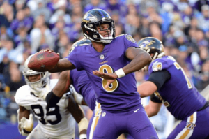 Baltimore Ravens player throwing the football