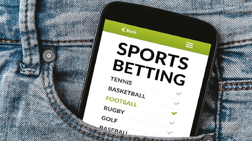 sports betting app on mobile phone in pocket