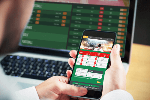sports betting on laptop and mobile