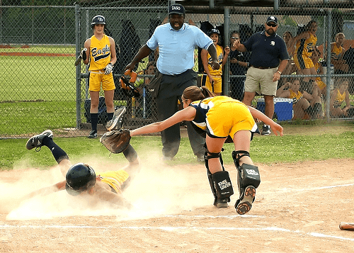 player sliding onto home base