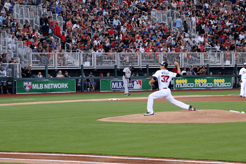 MLB player pitching the ball
